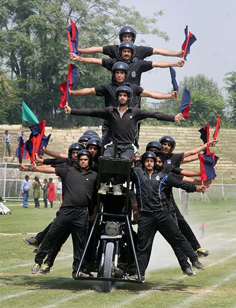 Jammu and Kashmir Police personnel performs during the full dress rehearsal of Independence Day parade at Bakhshi Stadium in Srinagar.