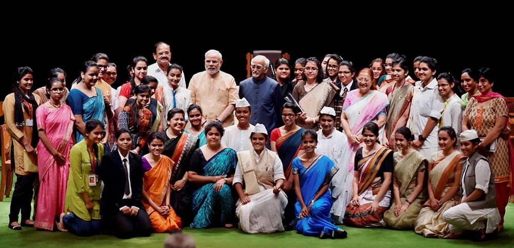 Vice President Hamid Ansari, Lok Sabha Speaker Sumitra Mahajan and PM Narendra Modi with Students of Presentation Convent School during the Outstanding Parliamentarian Awards.