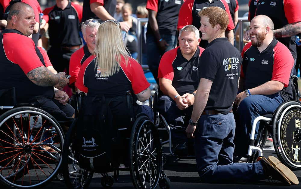 Britain`s Prince Harry speaks to the competitors during the announcement of the British Armed Forces team for the Invictus Games in London.