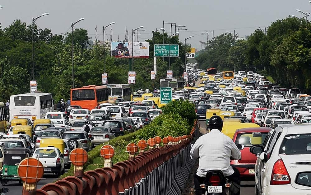 Vehicles stuck in a traffic jam at Nizamuddin bridge due to Independence Day rehearsals in New Delhi.