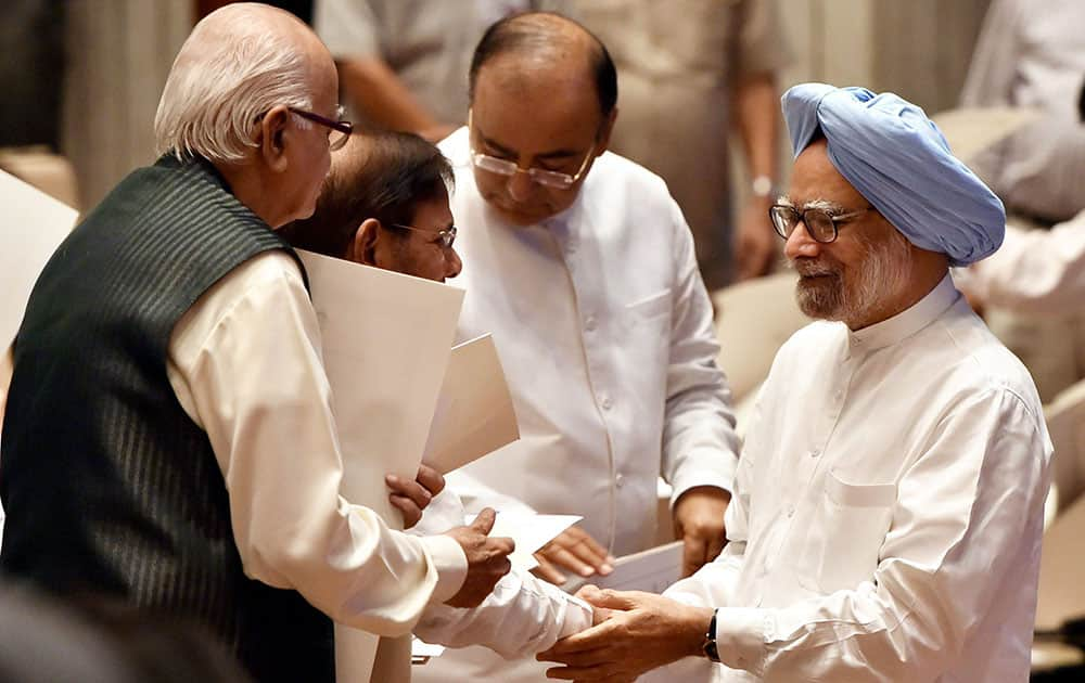 Former Prime Minister Manmohan Singh with Sharad Yadav, Arun Jaitley and senior BJP leader L K Advani at the Outstanding Parliamentarian Awards for 2010 2011 and 2012 in the Balyogi auditorium (PLB) in New Delhi.