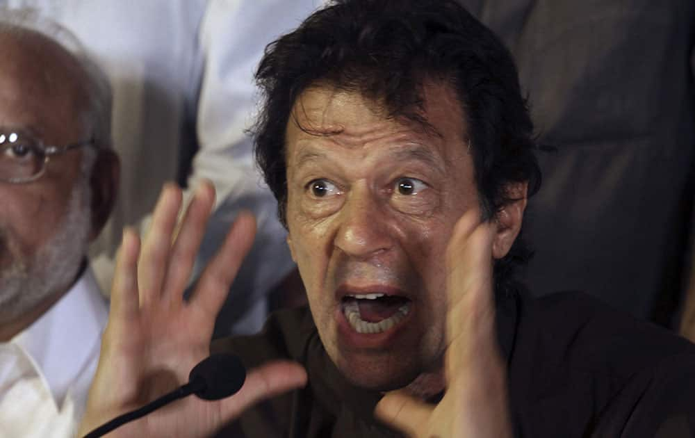 Pakistan`s cricketer-turned-politician Imran Khan, gestures during a press conference, in Lahore, Pakistan. Ahead of planned massive anti-government protests, Pakistan`s capital feels like a city preparing for a siege.