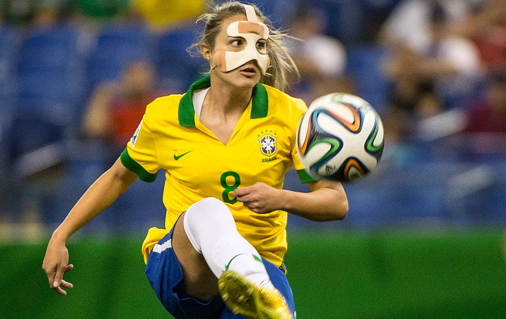 Brazil`s Djenifer plays the ball as they face Germany during first half FIFA U20 Women`s World Cup soccer action in Montreal.