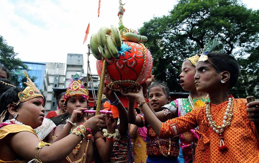 Children celebrating `Dahi Handi` in Thane, Mumbai.
