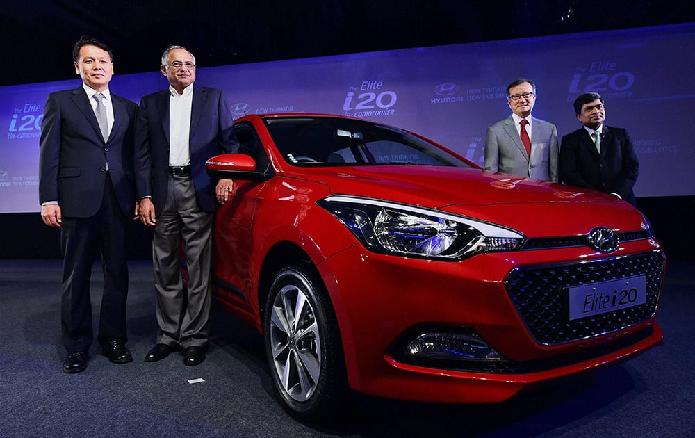 BS Seo, MD and CEO, Hyundai Motors India and Chairman of TVS Motors Venu Srinivasan (2nd from L) along with other company officials at the launch of Elite i20 car in Chennai.
