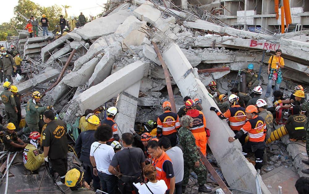 Thai rescue workers and soldiers continue their search at the site of a six-story building collapse in Pathum Thani province, just north of Bangkok, Thailand.