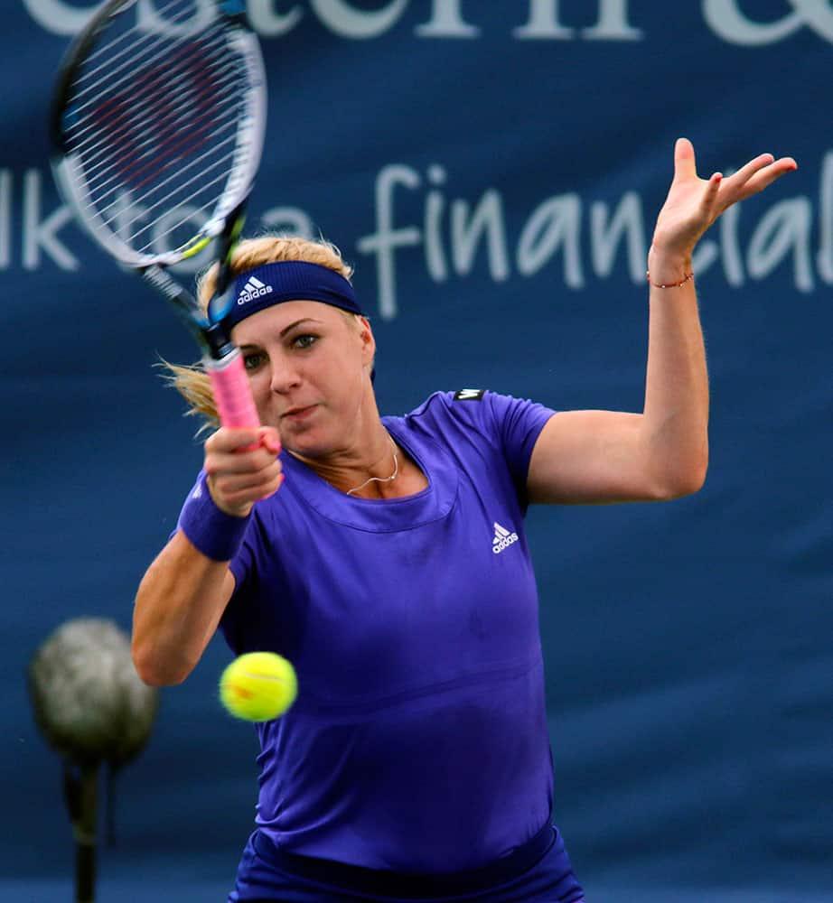 Anastasia Pavlyuchenkova, of Russia, returns a volley to Dominika Cibulkova, of Slovakia, at the Western & Southern Open tennis tournament.