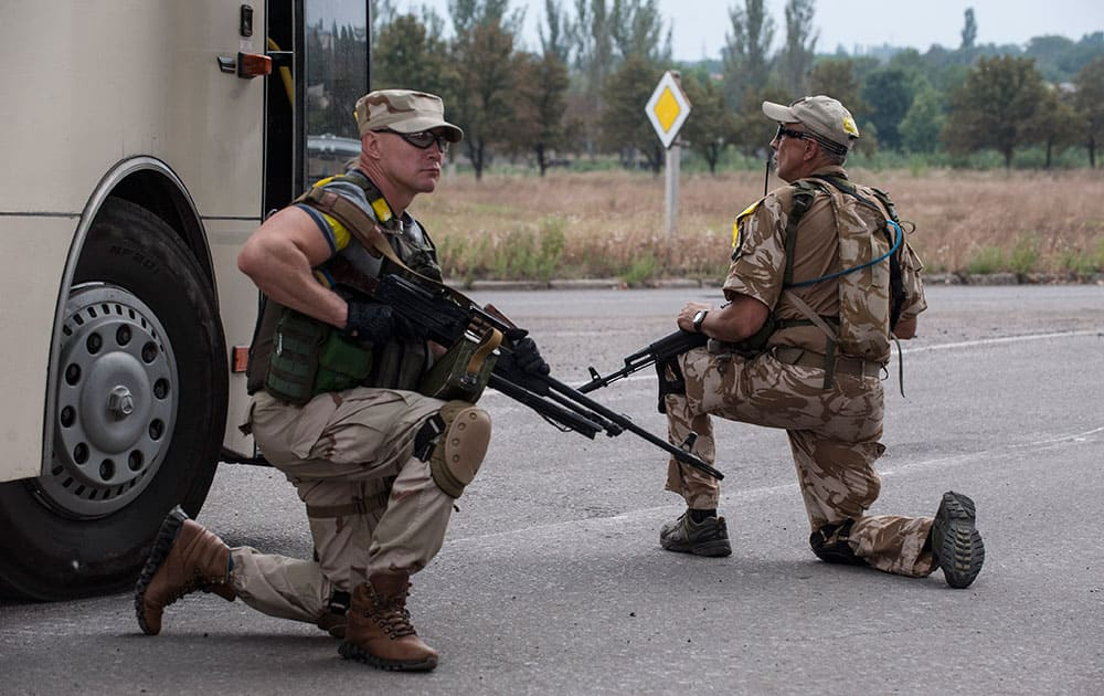 Ukrainian government soldiers from battalion `Donbass` guard at a checkpoint positions in village Mariinka near Donetsk, eastern Ukraine.