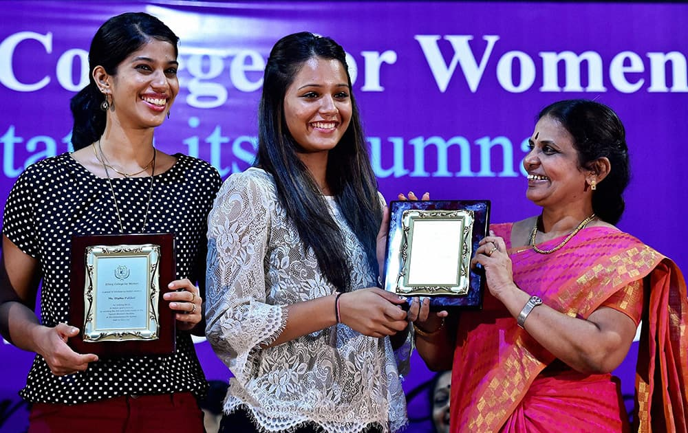 CWG squash gold medalists Dipika Pallikal and Joshna Chinappa at a felicitation programme at Ethiraj College for Women in Chennai.