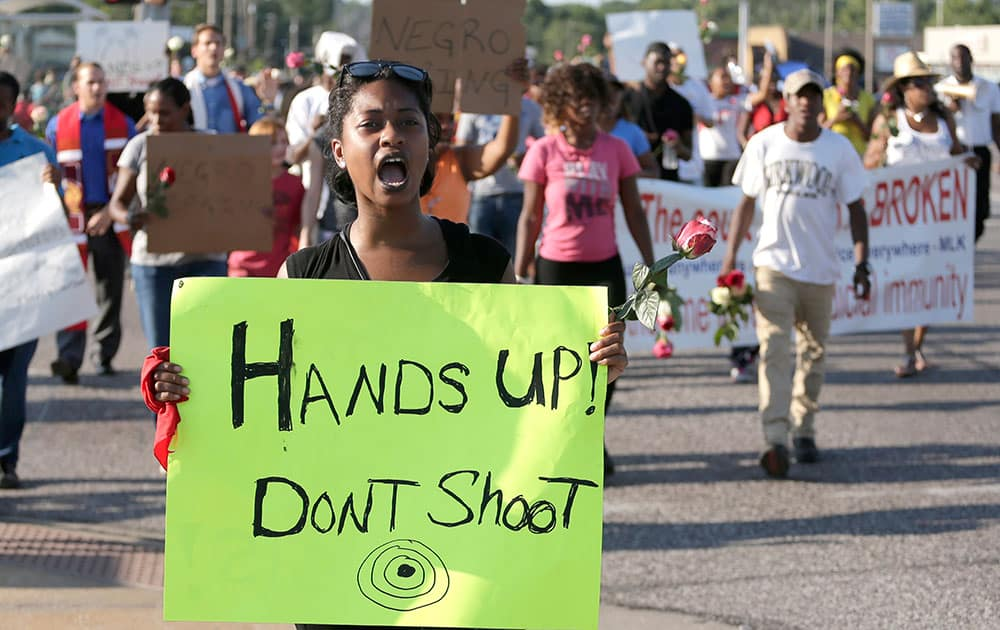 Protesters march for Michael Brown, who was killed by police Aug. 9 in Ferguson, Mo. Ferguson`s leaders urged residents Tuesday to stay home after dark to `allow peace to settle in` and pledged several actions to reconnect with the predominantly black community in the St. Louis suburb where the fatal shooting of 18-year-old Michael Brown has sparked nightly clashes between protesters and police.