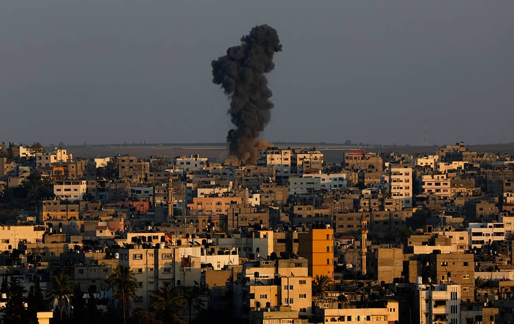 Smoke and dust rise after an Israeli strike hit Gaza City in the northern Gaza Strip.