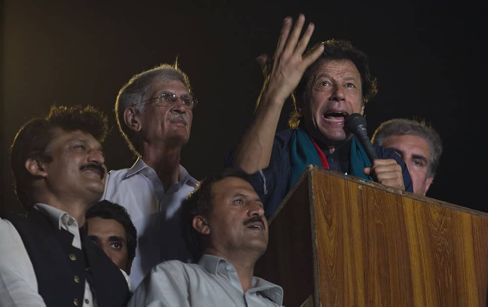 Pakistan`s cricketer-turned-politician Imran Khan motivates his supporters to march to Parliament House in Islamabad, Pakistan.