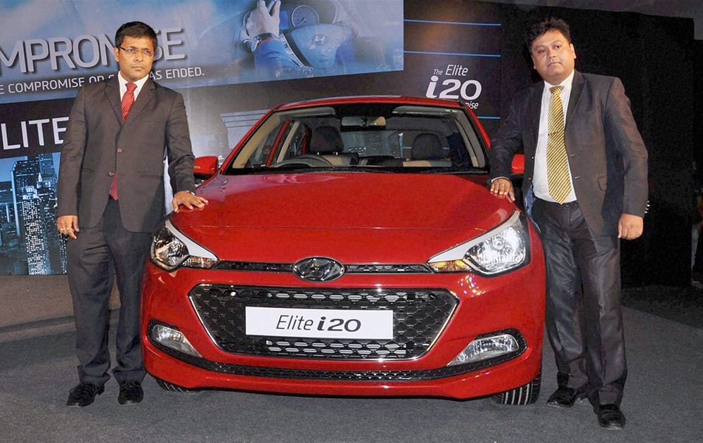 Zonal Manager of Hyundai Motor India Limited Tapan Kumar Ghosh and Regional Manager Bedabrata Bordoloi at the launch of Elite i20 car in Guwahati.