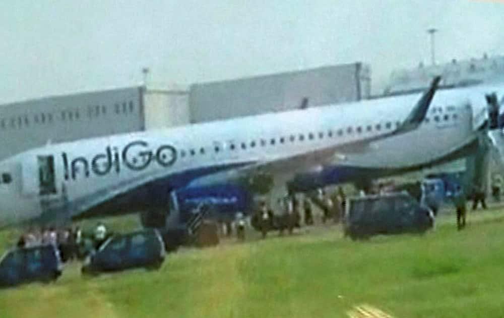The IndiGo flight which caught fire while landing at the Indira Gandhi International Airport in New Delhi.