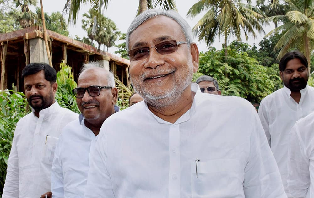 Former Bihar Chief Minister and Janata Dal (United) leader Nitish Kumar arrives for a press conference at his residence in Patna after Bihar bypoll results.