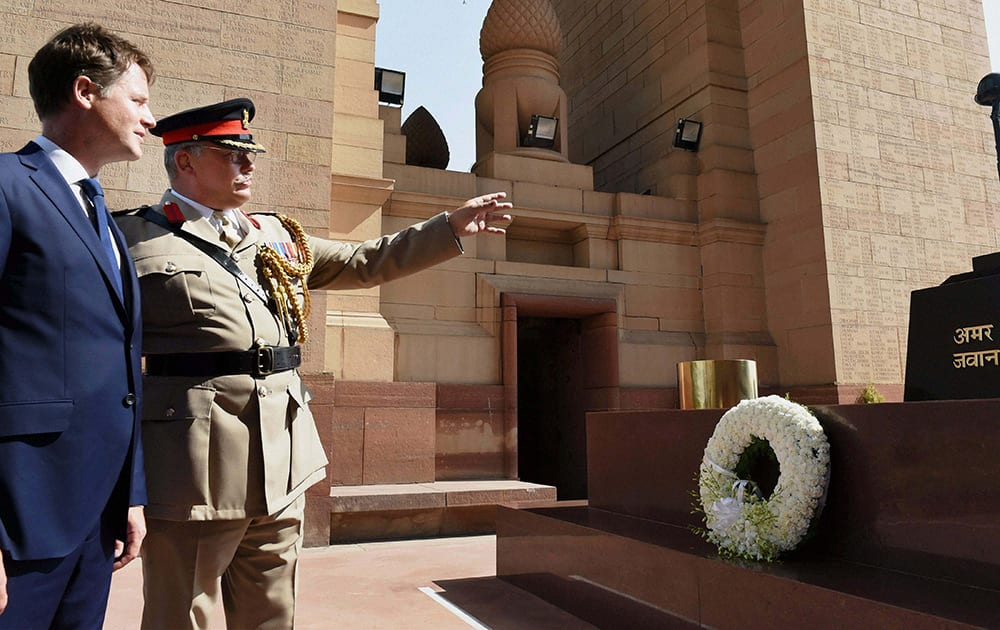 Britain's Deputy Prime Minister Nick Clegg after laying a wreath at Amar Jawan Jyoti at the India Gate in New Delhi.