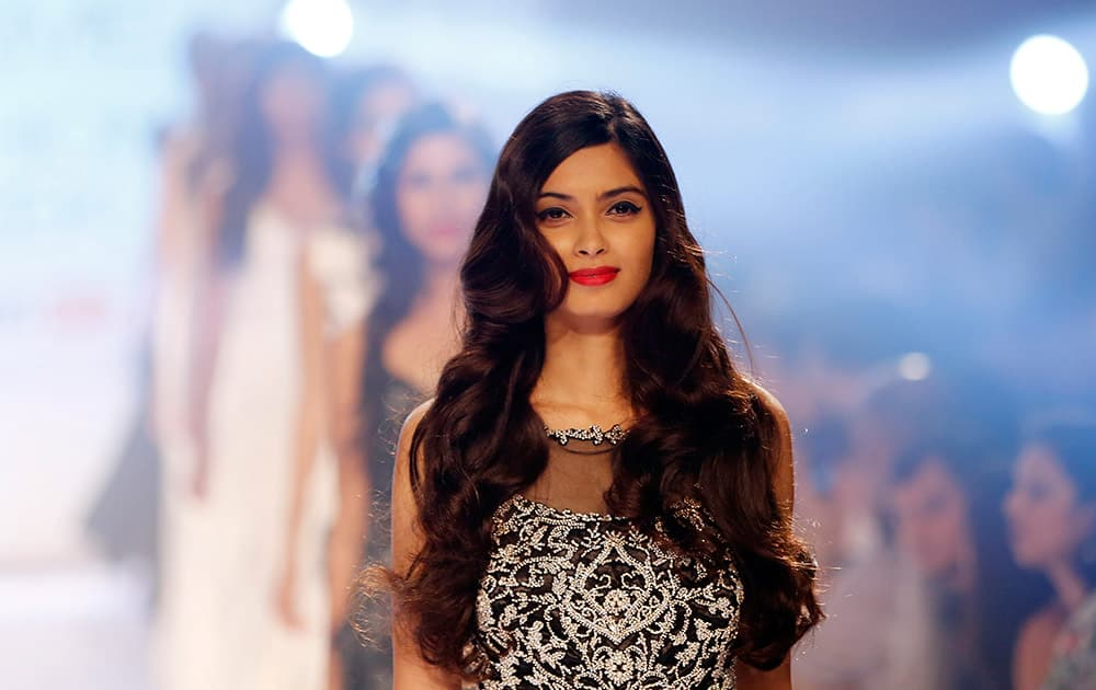Bollywood actress Diana Penty displays a creation by Rocky Star during the Lakme Fashion Week in Mumbai.