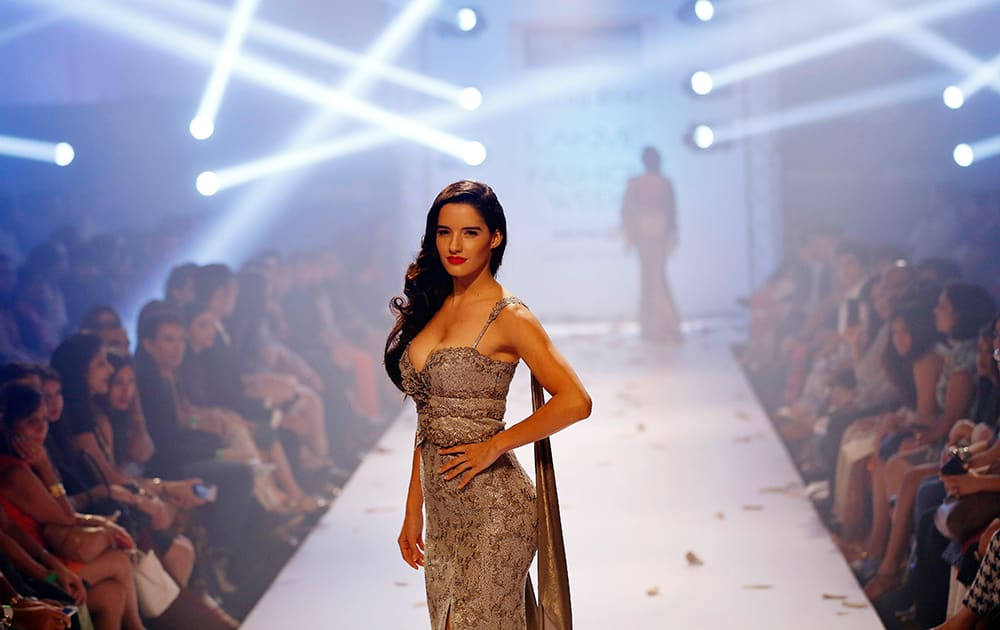 A model displays a creation by Rocky Star during the Lakme Fashion Week in Mumbai