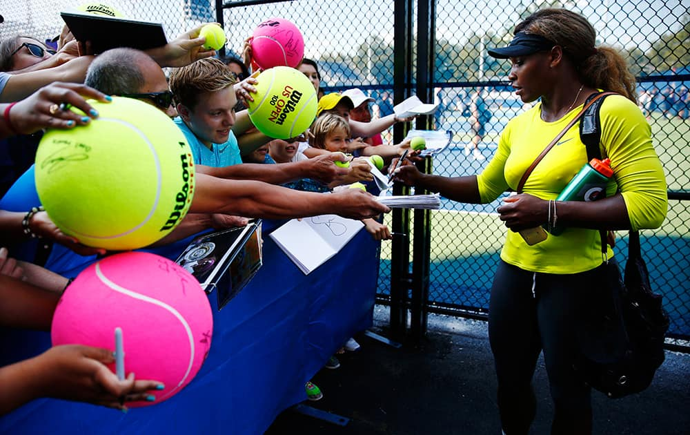 Serena Williams signs autographs after practicing ahead of the of the 2014 US Open tennis tournamen in New York.