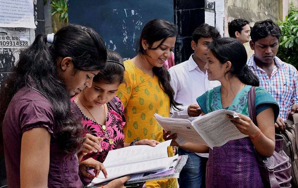 Students discussing with their friends after appearing for the Union Public Service Commission (UPSC) exam in Patna.