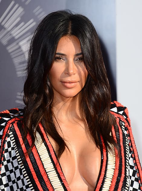 Kim Kardashian arrives at the MTV Video Music Awards at The Forum in Inglewood, Calif.