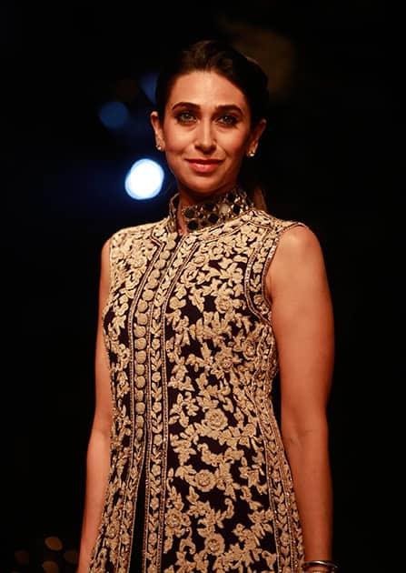 Karisma Kapoor poses for photographs on the sidelines of the Lakme Fashion Week in Mumbai.