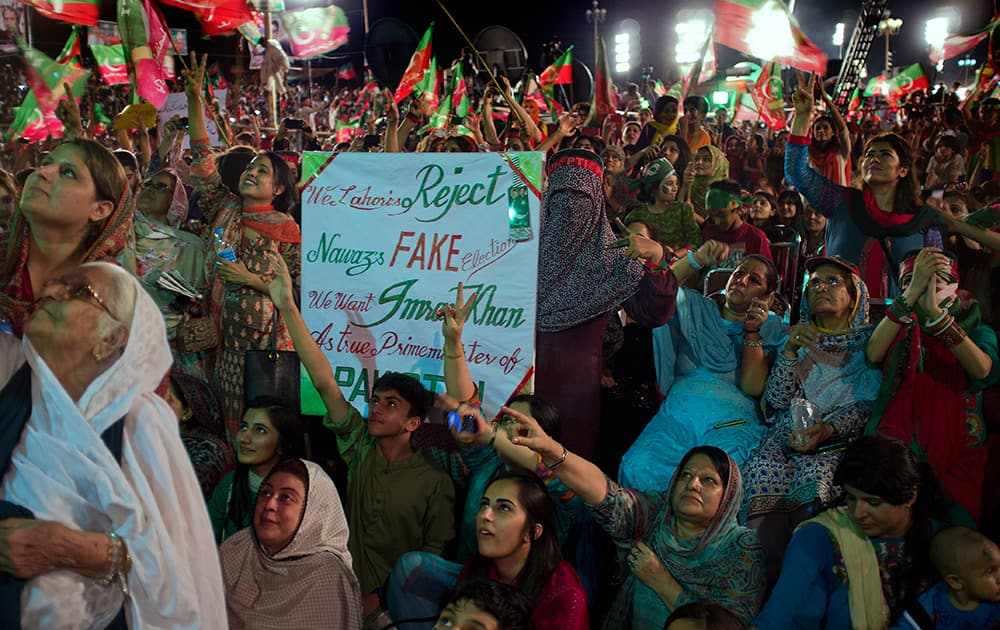 Supporters of Pakistan`s cricket celebrity-turned-politician Imran Khan listen to their leader at a rally in Islamabad, Pakistan.