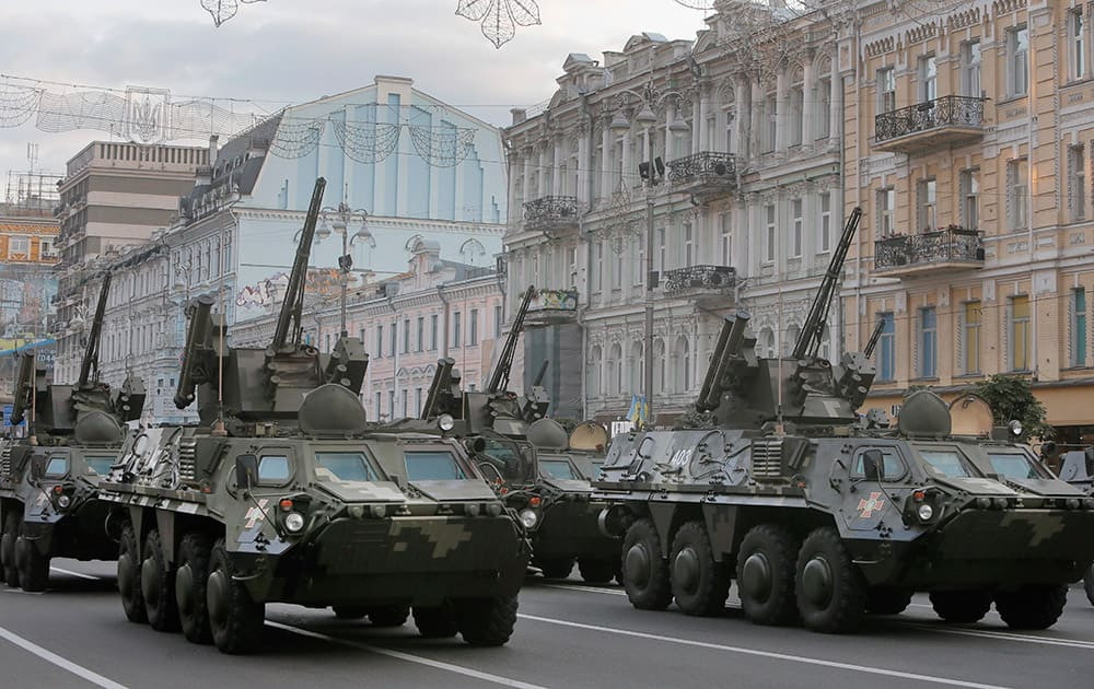 Ukrainian military vehicles pass during a parade rehearsal in central Khreshchatyk street in Kiev, Ukraine.