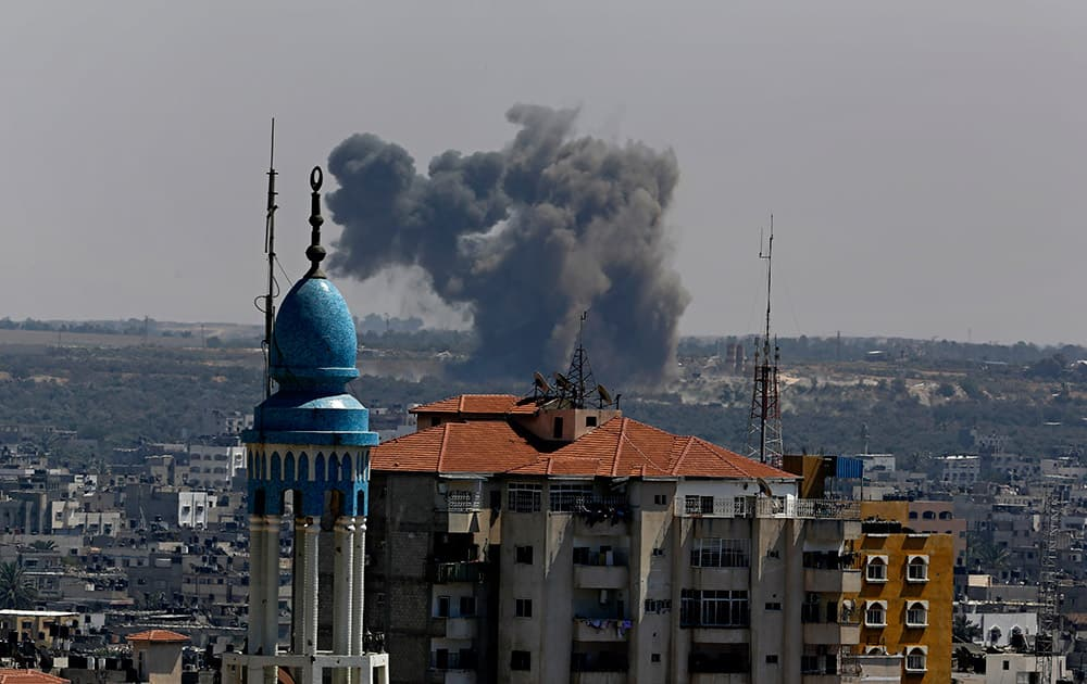 Smoke and dust rise after an Israeli strike hits Gaza City in the northern Gaza Strip.