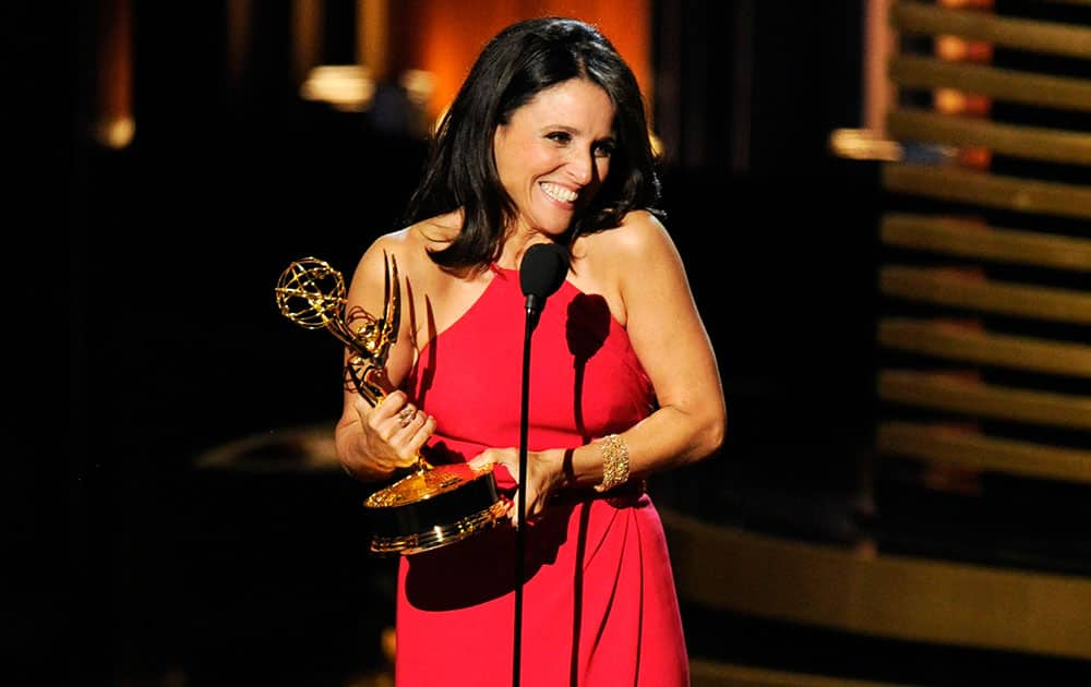 """Julia Louis-Dreyfus accepts the award for outstanding lead actress in a comedy series for her work on """"Veep"""" at the 66th Annual Primetime Emmy Awards at the Nokia Theatre L.A."""