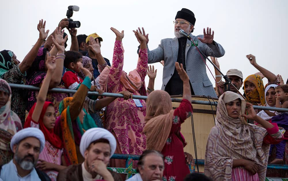 Pakistan's Muslim cleric Tahir-ul-Qadri addresses his supporters during an anti-government sit-in protest near the parliament building in Islamabad.