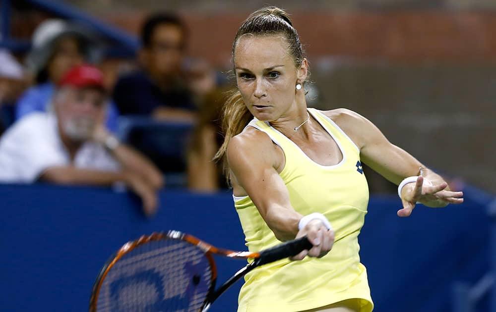 Magdalena Rybarikova, of Slovakia, returns a shot to Caroline Wozniacki, of Denmark, during the opening round of the US Open tennis tournament, in New York.