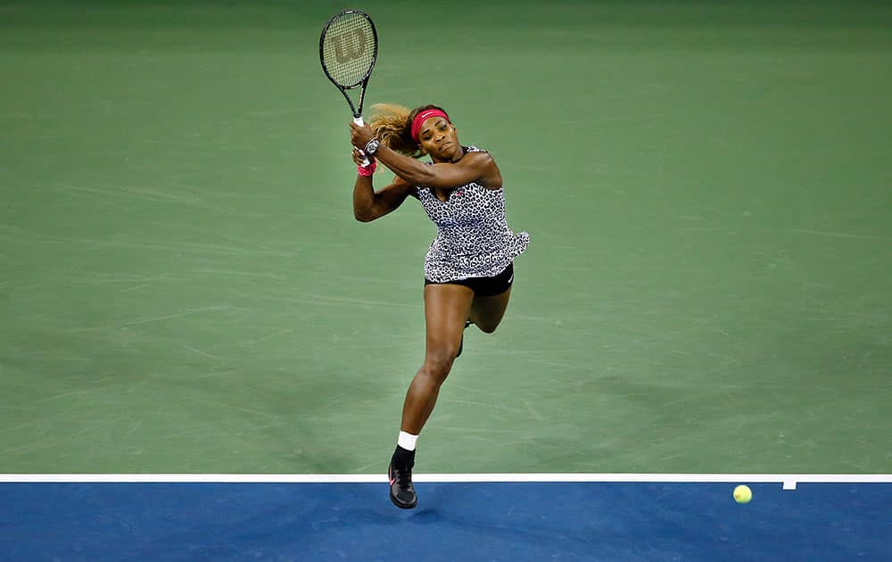 Serena Williams, of the United States, returns a shot to Taylor Townsend, of the United States, during the opening round of the US Open tennis tournament, in New York.