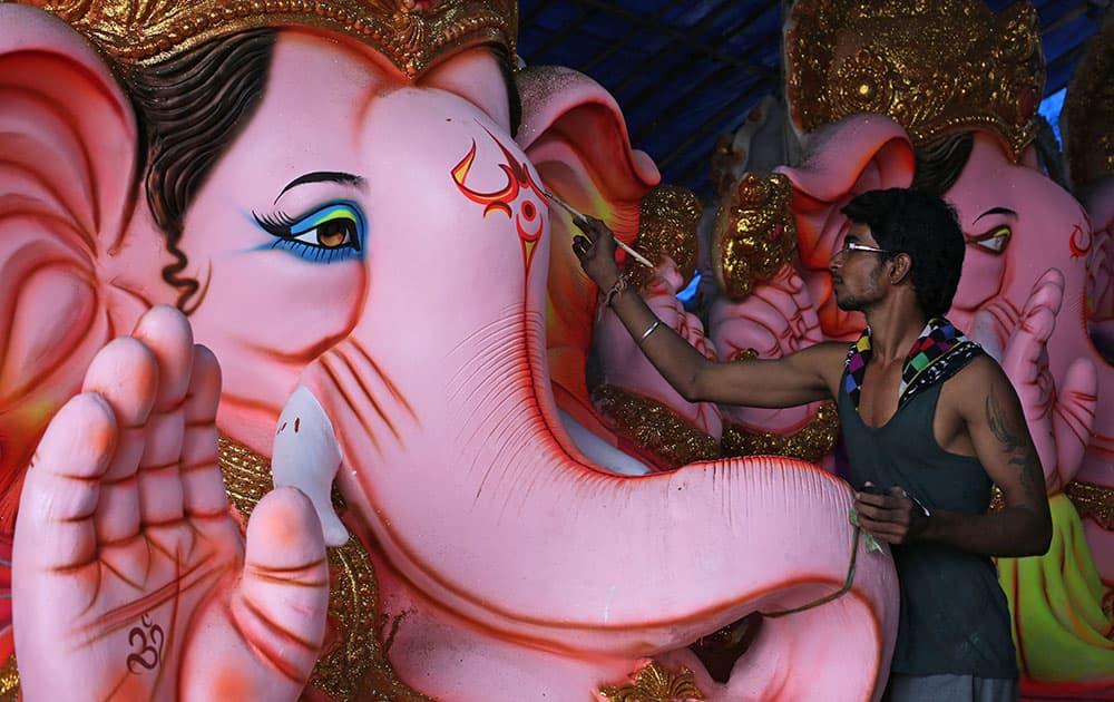 An Indian artist paints an idol of elephant-headed Hindu god Ganesha ahead of Ganesha Chaturthi festival in Hyderabad.