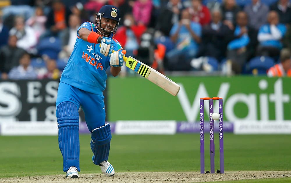 Suresh Raina hits four runs off the bowling of England's Chris Jordan during their One Day International cricket match at the SWALEC cricket ground in Cardiff, Wales.