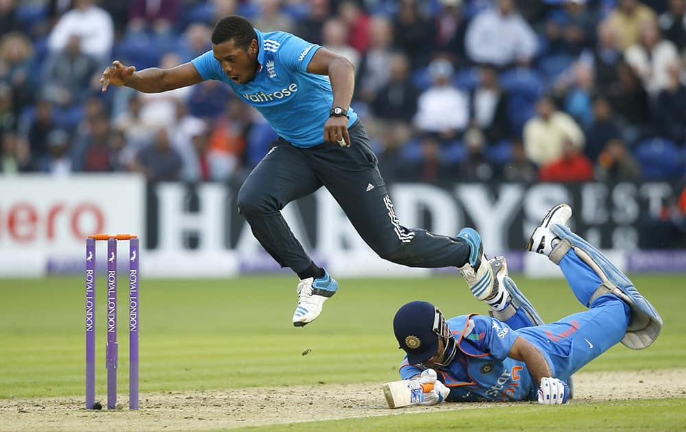 England's bowler Chris Jordan collides with India's MS Dhoni, during an attempted run out, in their One Day International cricket match at the SWALEC cricket ground in Cardiff, Wales.