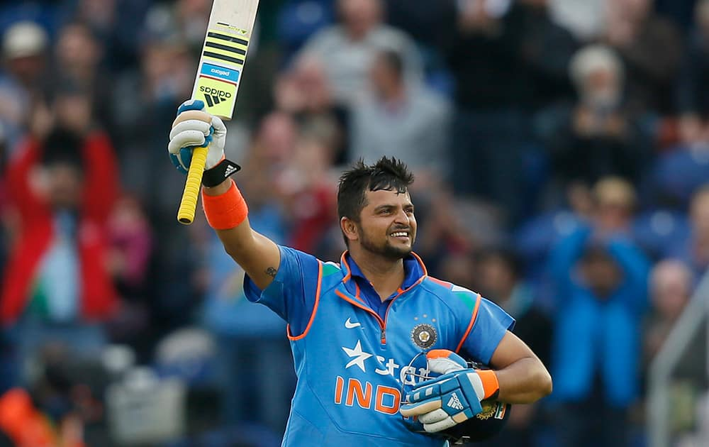India's Suresh Raina celebrates getting 100 runs not out, during their One Day International cricket match against England at the SWALEC cricket ground in Cardiff, Wales.