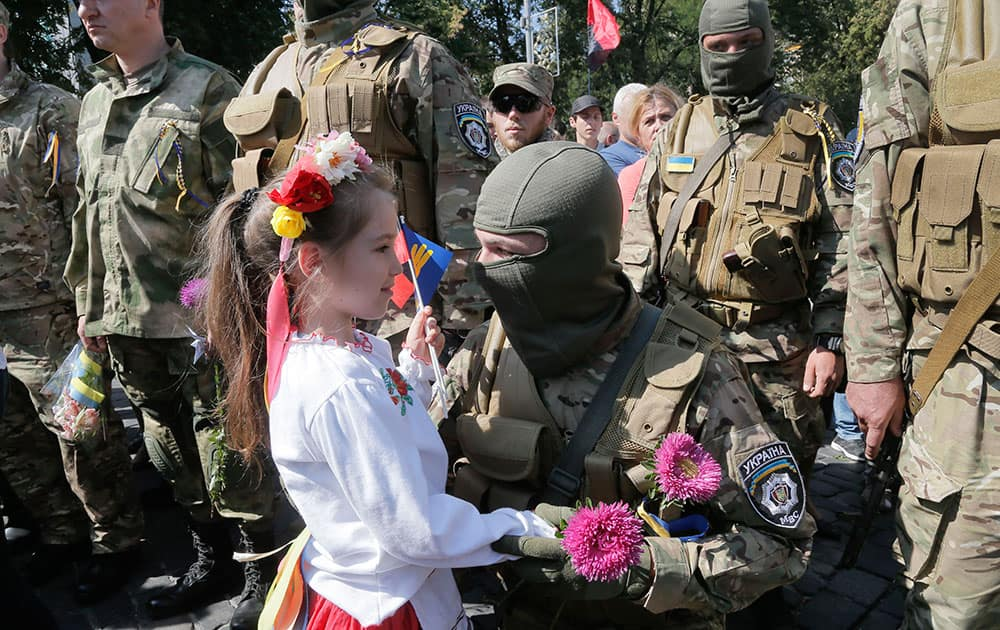 Relatives and friends say goodbye to volunteers before they were sent to the eastern part of Ukraine to join the ranks of special battalion unit fighting against pro-Russian separatists, in Kiev, Ukraine.