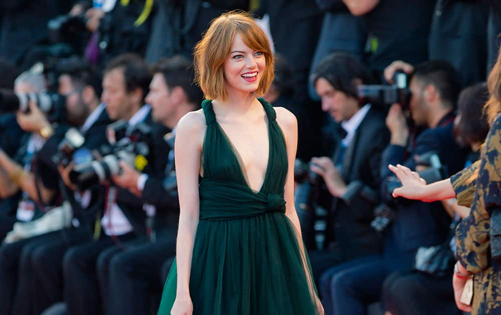 Actress Emma Stone arrives for the screening of the movie Birdman during the opening ceremony of the 71st edition of the Venice Film Festival in Venice, Italy.