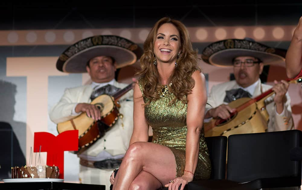 TV personality Lucero is surprised with a birthday cake and music from a mariachi band during a press conference in Miami Beach, Fla.