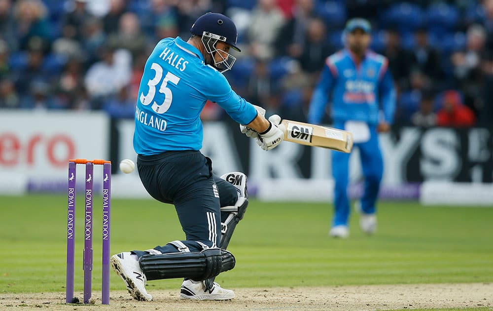 England's Eoin Morgan hits a ball bowled by India's Ravindra Jadeja during their One Day International cricket match at the SWALEC cricket ground in Cardiff, Wales.