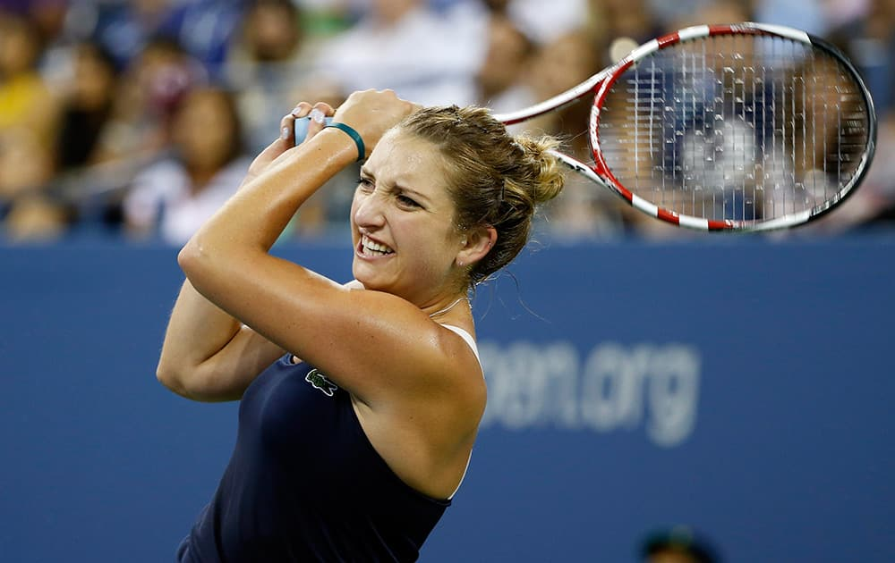 Timea Bacsinszky, of Switzerland, watches a return to Venus Williams, of the United States, during the second round of the U.S. Open tennis tournament in New York.