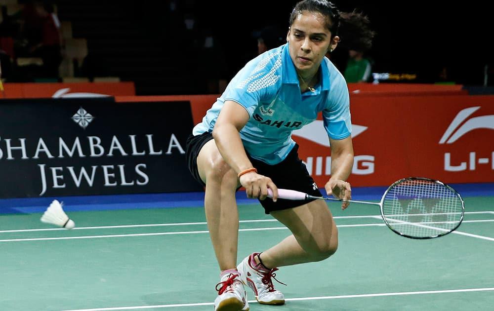 Saina Nehwal returns a shot to Japan's Sayaka Takahashi, during their match at the World Badminton Championships at Ballerup Arena, Denmark.