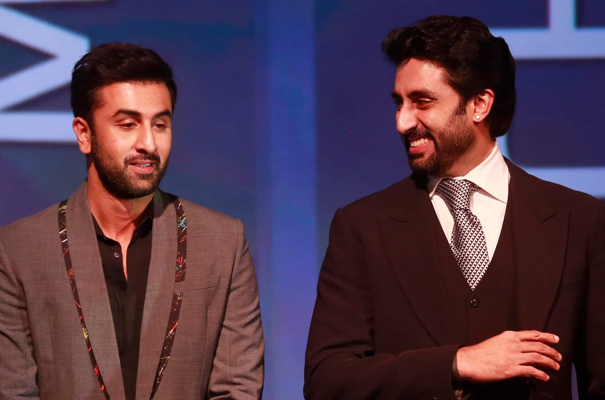 Bollywood actor and co-owner of Mumbai City FC Ranbir Kapoor, listens to Bollywood actor and co-owner of Team Chennai Abhishek Bachchan during the official launch of the Indian Super League (ISL) in Mumbai.