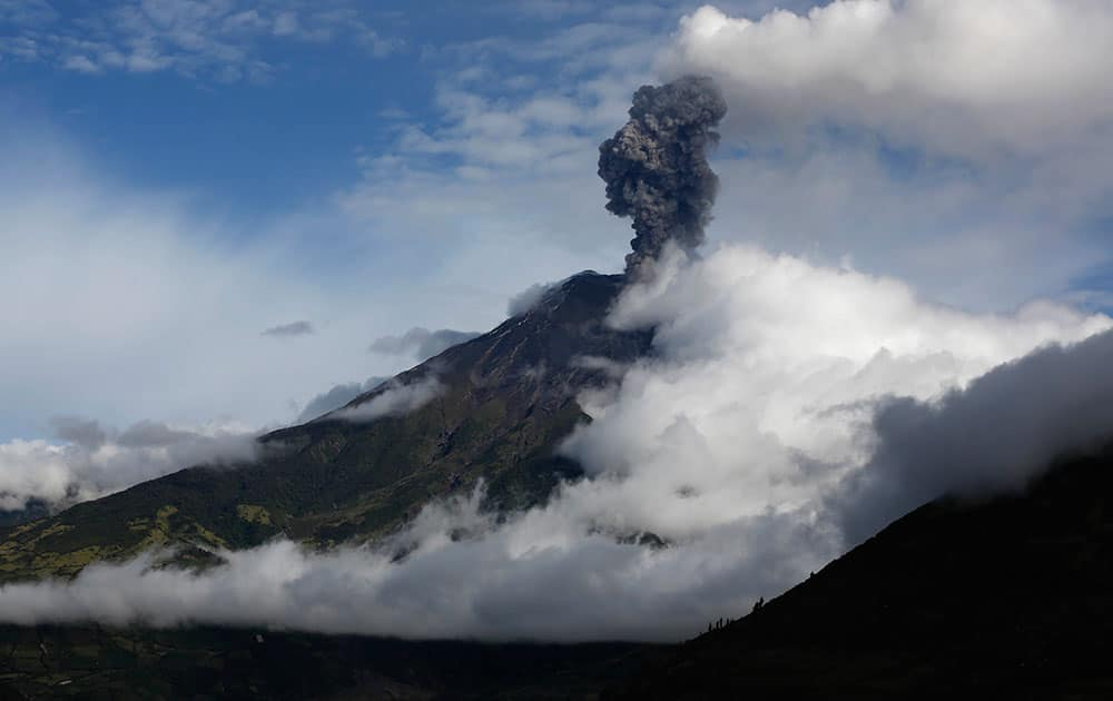 The Tungurahua volcano blows steam and ash, seen from El Tingue, Ecuador