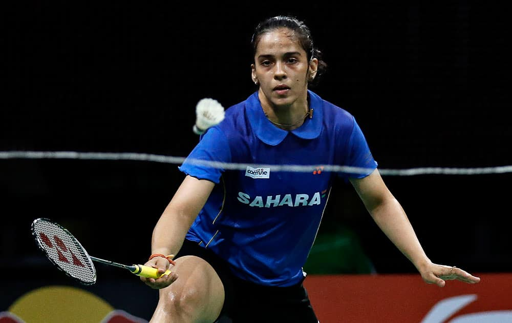 Saina Nehwal returns a shot to China's top seeded Li Xuerui, not seen, during their Quarter Final match at the World Badminton Championships at Ballerup Arena, Denmark.