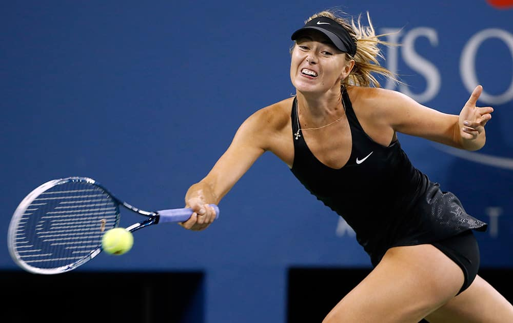Maria Sharapova, of Russia, returns a shot to Sabine Lisicki, of Germany, during the third round of the U.S. Open tennis tournament in New York. Sharapova won 6-2, 6-4.