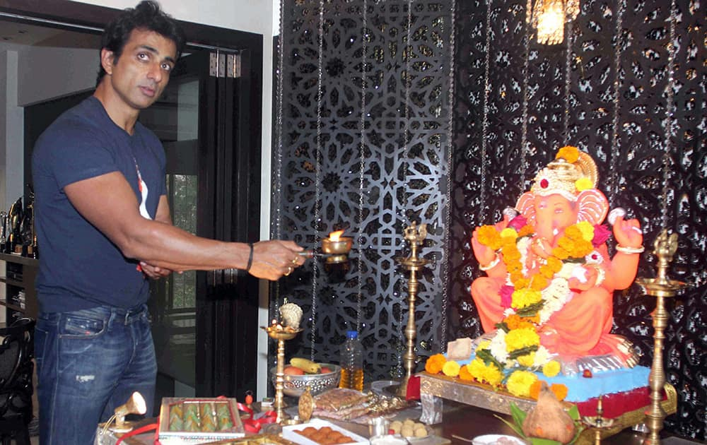 Sonu Sood offers prayers to a Ganesh idol at his residence on the occasion of Ganesh Chaturthi, in Mumbai.