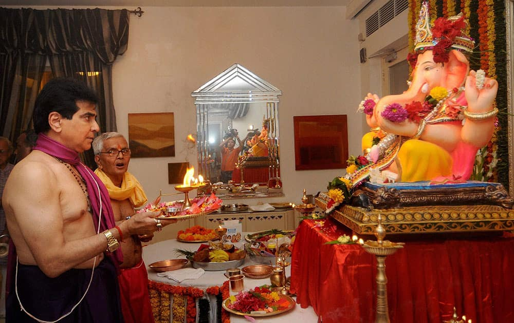 Bollywood actor Jeetendra offers prayers to a Ganesh idol at his residence on the occasion of Ganesh Chaturthi, in Mumbai.
