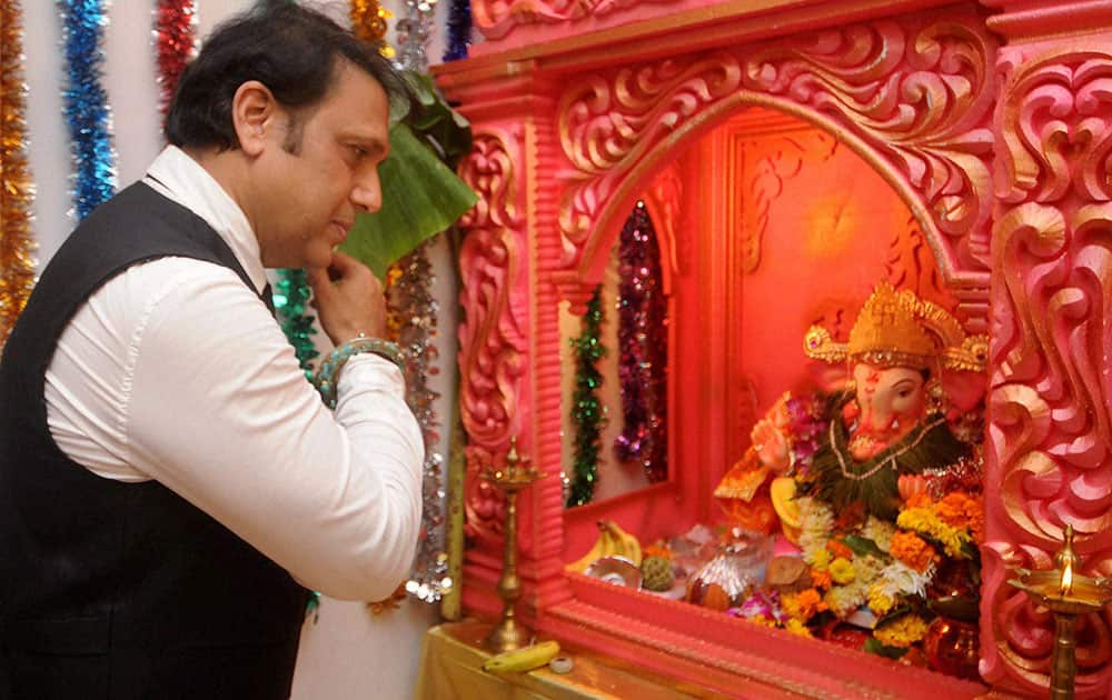 Bollywood actor Govinda offers prayers to a Ganesh idol at his residence on the occasion of Ganesh Chaturthi, in Mumbai.